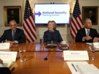 Hillary Clinton (C) meets with national security advisors during a National Security Working Session on September 9, 2016 in New York City.