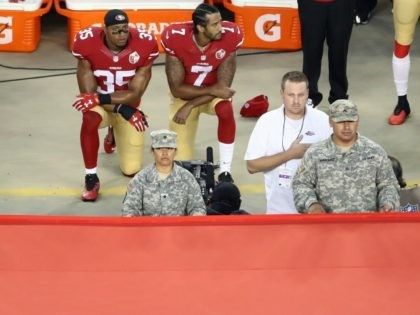 Colin Kaepernick #7 and Eric Reid #35 of the San Francisco 49ers kneel in protest during the national anthem September 12, 2016 in Santa Clara, California.