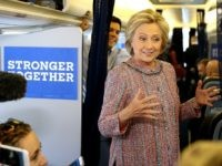Hillary Clinton speaks to members of the traveling press aboard her campaign plane  September 15, 2016 in White Plains, New York.