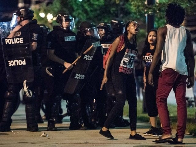 Demonstrators argue amongst themselves during protests September 22, 2016 in downtown Charlotte, NC.