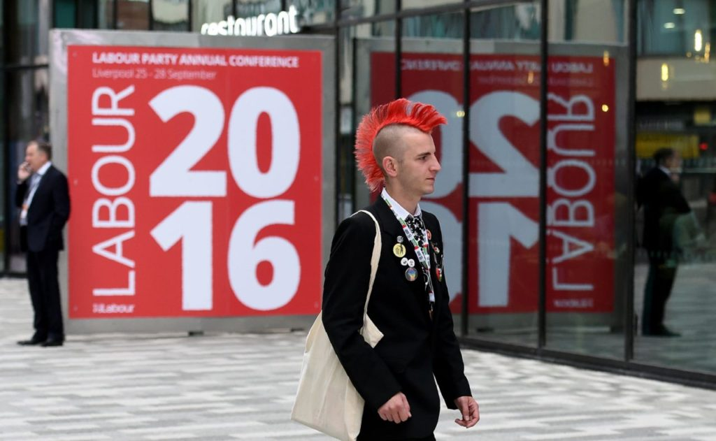 A delegate arrives for the third day of annual Labour Party conference in Liverpool, north west England on September 27, 2016. Distracted by a bitter leadership contest, Britain's main opposition Labour party has struggled to present a vision of Brexit to challenge the ruling Conservatives -- and many fear the re-election of Jeremy Corbyn will do little to change this. / AFP / PAUL ELLIS (Photo credit should read PAUL ELLIS/AFP/Getty Images)