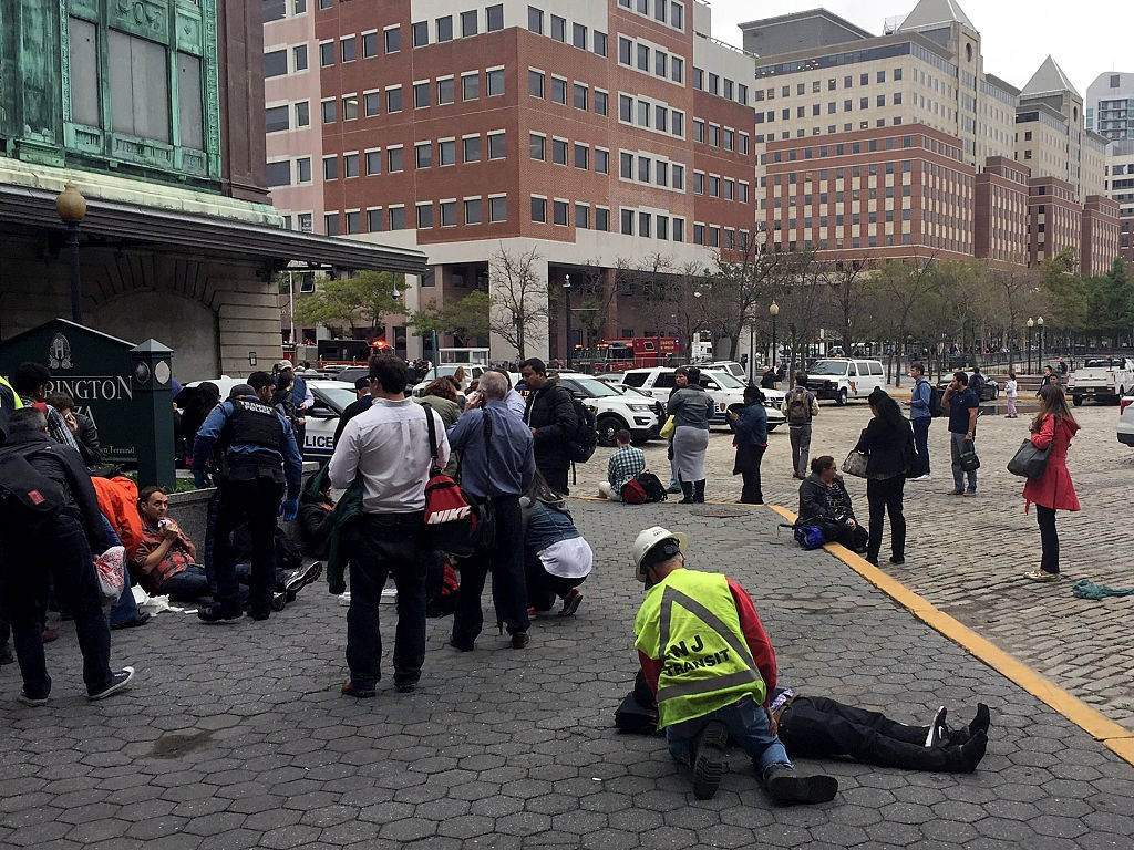 HOBOKEN, NJ - SEPTEMBER 29: People are treated for their injuries outside after a NJ Transit train crashed in to the platform at Hoboken Terminal September 29, 2016 in Hoboken, New Jersey. (Photo by Pancho Bernasconi/Getty Images)