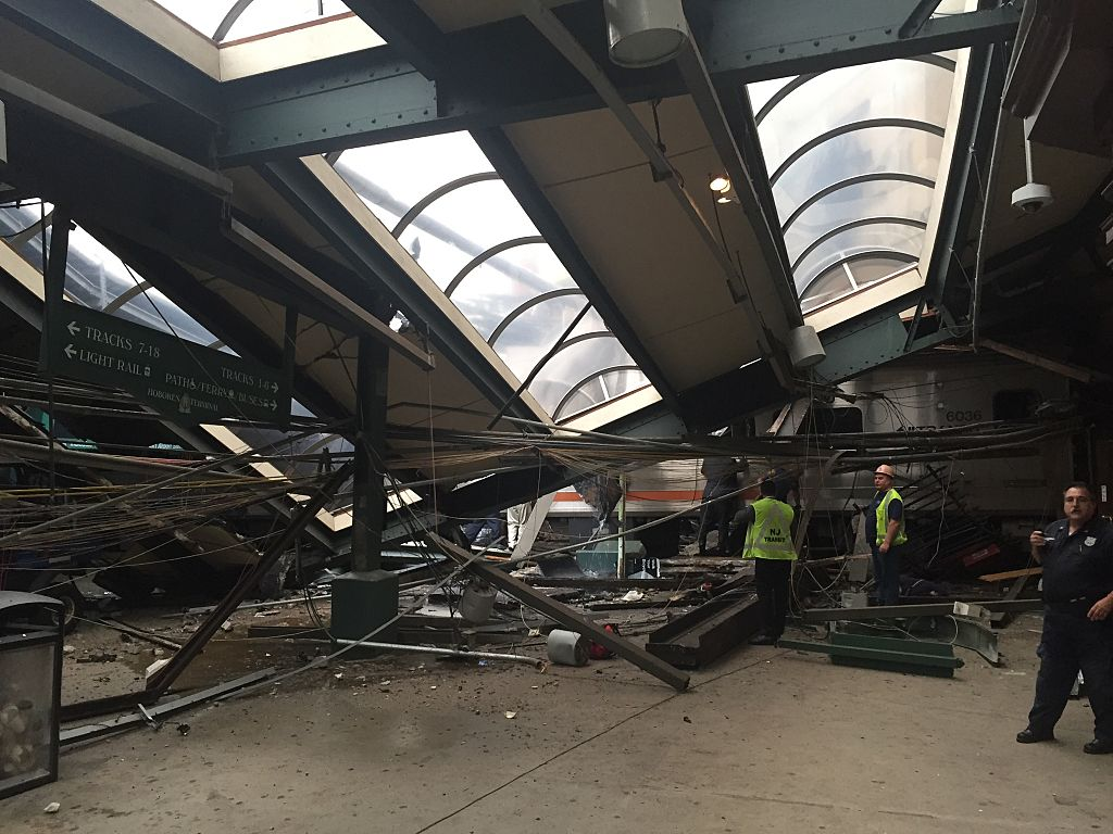 HOBOKEN, NJ - SEPTEMBER 29: A NJ Transit train seen through the wreckage after it crashed in to the platform at the Hoboken Terminal September 29, 2016 in Hoboken, New Jersey. (Photo by Pancho Bernasconi/Getty Images)
