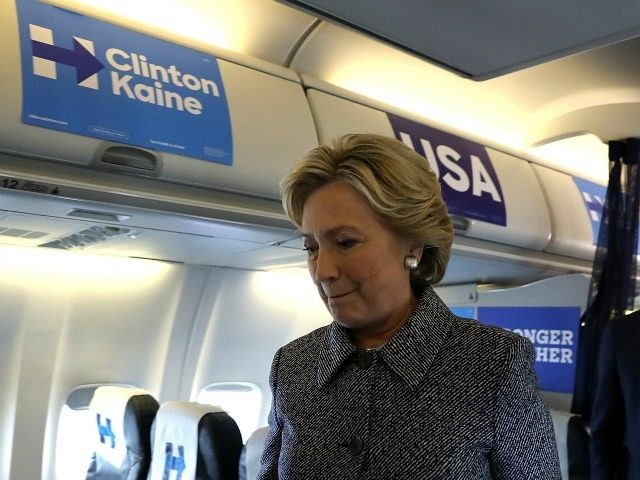 Democratic presidential nominee former Secretary of State Hillary Clinton returns to her cabin after speaking to reporters aboard her campaign plane at Chicago Midway Airport on September 29, 2016 in Chicago, Illinois.
