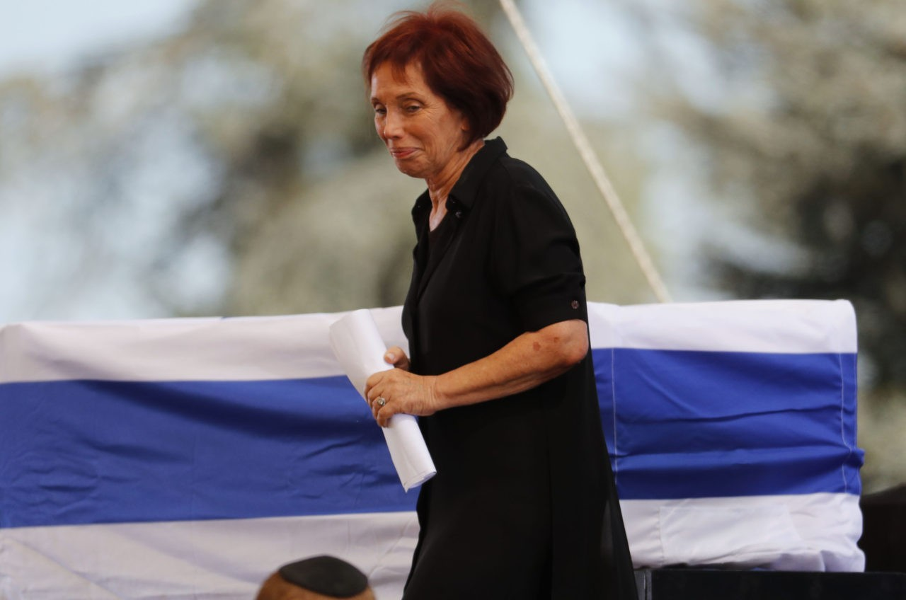 Tsvia Walden, the daughter of former Israeli president and Nobel Peace Prize winner Shimon Peres, walks past her father's casket during his funeral at Jerusalem's Mount Herzl national cemetery on September 30, 2016. World leaders including US President Barack Obama and Prince Charles were bidding farewell to Peres as his funeral began under massive security. / AFP / Thomas COEX (Photo credit should read THOMAS COEX/AFP/Getty Images)