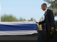 In this handout photo provided by the Israel Government Press Office (GPO), U.S President Barack Obama touches the coffin of Shimon Peres September 30, 2016 in Jerusalem, Israel. World leaders and dignitaries from 70 countries attended the state funeral of Israel's ninth president, Shimon Peres, in Jerusalem on Friday.