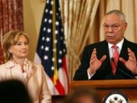 Former U.S. Secretary of State Colin Powell (R) speaks with U.S. Secretary of State Hillary Clinton December 7, 2009 in Washington, DC.