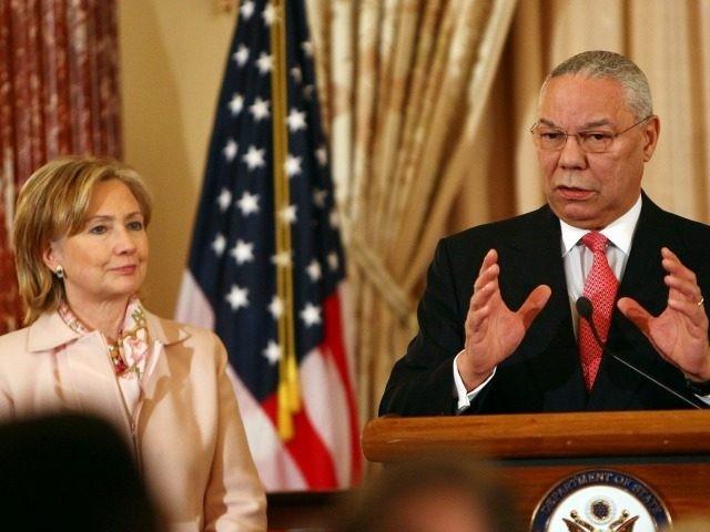 Former U.S. Secretary of State Colin Powell (R) speaks with U.S. Secretary of State Hillary Clinton December 7, 2009 in Washington, DC.