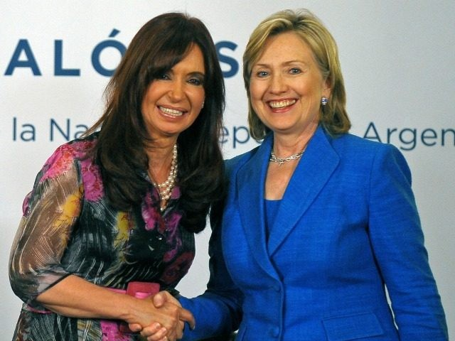 Argentine President Cristina Fernandez de Kirchner (L) and US Secretary of State Hillary Clinton shake hands in Buenos Aires on March 1, 2010.