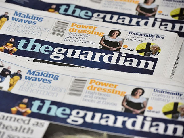 An arrangment of Guardian newspapers is photographed in an office in London on January 26, 2016. The Guardian newspaper is to cut running costs by 20 percent over three years and may begin charging for some online content following a 25-percent plunge in print advertising, British media reported Tuesday. / …