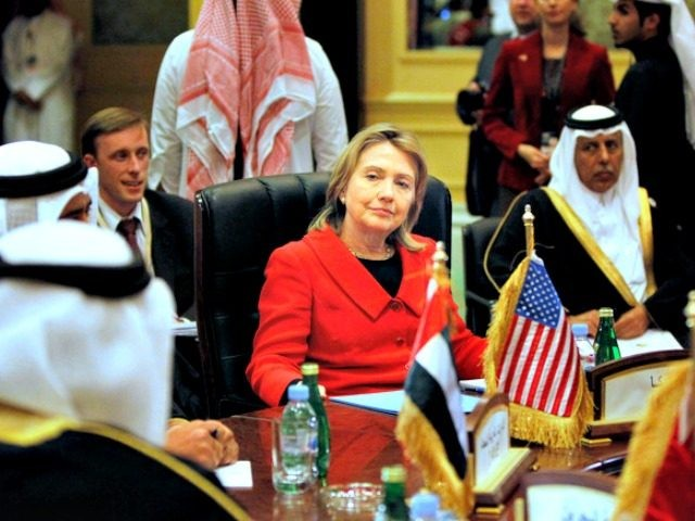 FILE- In this Wednesday, January 12, 2011 file photo, U.S. Secretary of State Hillary Rodham Clinton, center, talks to Gulf Cooperation Council Foreign Ministers during a meeting in Doha, Qatar. For the Middle East, Hillary Clinton is a known commodity. While presumptive Republican presidential nominee Donald Trump's comments on banning …