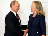 U.S. Secretary of State Hillary Rodham Clinton, right, is greeted by Russian President Vladimir Putin during the arrival ceremony for the Asia-Pacific Economic Cooperation (APEC) Summit in Vladivostok, Russia, Saturday, Sept. 8, 2012. (AP Photo/Jim Watson, Pool)