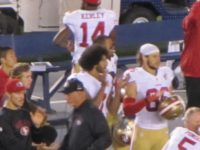 Kaepernick applauds 'God Bless America' (Michelle Moons / Breitbart News)