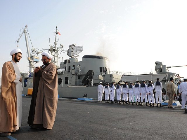 "Iranian clerics standing in front of the ""Jamran"", Iran's first domestically built warship, during naval maneuvers in the Gulf on February 21, 2009. Iran's navy on February 19 launched in the Gulf its first domestically made destroyer in a ceremony attend by the supreme leader and the commander-in-chief Ayatollah Ali …"