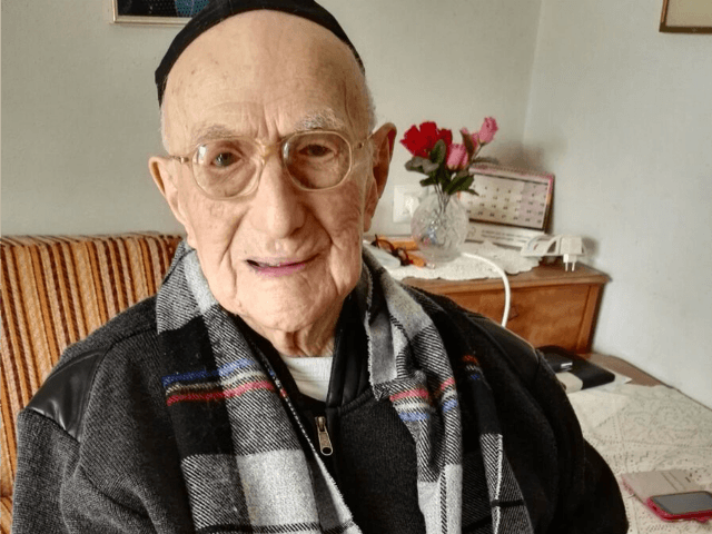 A picture taken on January 21, 2016, shows Yisrael Kristal sitting in his home in the Israeli city of Haifa. Yisrael, an Israeli Holocaust survivor, may be the world's oldest man at 112, Guinness World Records said, providing he can find the documents to prove it. His family say he …