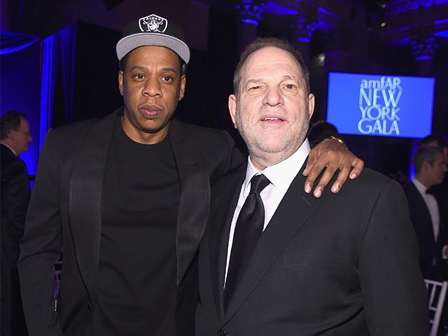 Jay Z (L) and Harvey Weinstein attend the 2016 amfAR New York Gala at Cipriani Wall Street on February 10, 2016 in New York City. (Photo by Jamie McCarthy/Getty Images)