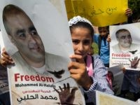 Palestinian children hold posters of Mohammed Halabi (L), the Gaza director of World Vision, a major US-based Christian NGO, during a protest to support him at Rafah town in the southern Gaza Strip on August 29, 2016. On August 4 an Israeli court charged Halabi, the Gaza director of the …