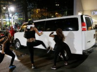 Demonstrators protest Tuesday's fatal police shooting of Keith Lamont Scott in Charlotte, N.C. on Wednesday, Sept. 21, 2016. Protesters rushed police in riot gear at a downtown Charlotte hotel and officers have fired tear gas to disperse the crowd. At least one person was injured in the confrontation, though it …