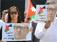 Protesters hold portraits of prominent Jordanian writer Nahed Hattar, who was shot dead the previous day outside an Amman court, during a demonstration in front of the prime minister's offices on September 26, 2016. Jordan's judiciary slapped a media blackout on the murder of the Christian writer who was gunned down outside a court where he faced charges over an anti-Islam cartoon. Hattar was hit by three bullets before the alleged assassin was arrested at the scene of Sunday's shooting in Amman's central Abdali district, official media said. / AFP / Khalil MAZRAAWI (Photo credit should read KHALIL MAZRAAWI/AFP/Getty Images)