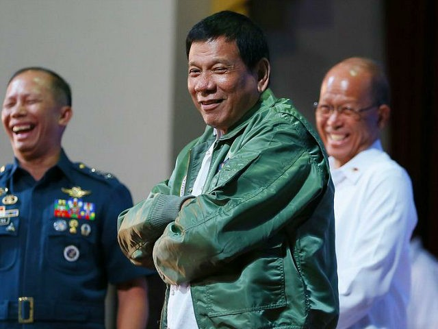 "Philippine President Rodrigo Duterte wears a pilot's jacket which was presented to him during his ""Talk with the Airmen"" on the anniversary of the 250th Presidential Airlift Wing Tuesday, Sept. 13, 2016 at the Philippine Air Force headquarters in suburban Pasay city, southeast of Manila, Philippines. On Monday, President Duterte, …"