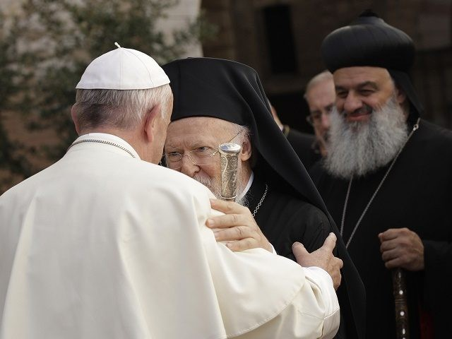 Pope Francis (L) greets Orthodox Patriarch of Constantinople Bartholomew I (C) upon arrival at the Saint Francis basilica in Assisi on September 20, 2016. Pope Francis denounced those who wage war in the name of God, as he met faith leaders and victims of war to discuss growing religious fanaticism …