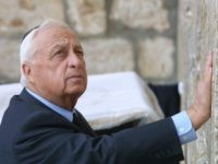 Israeli Prime Minister-elect Ariel Sharon places his hand on the Western Wall, Judaism's holiest site, in the Old City of Jerusalem 07 February 2001. Prime Minister Ariel Sharon was fighting for life 05 January 2006, after suffering a massive brain haemorrhage, throwing Israel into turmoil barely three months before a general election likely to determine the future of Middle East peacemaking. AFP PHOTO/THOMAS COEX (Photo credit should read THOMAS COEX/AFP/Getty Images)
