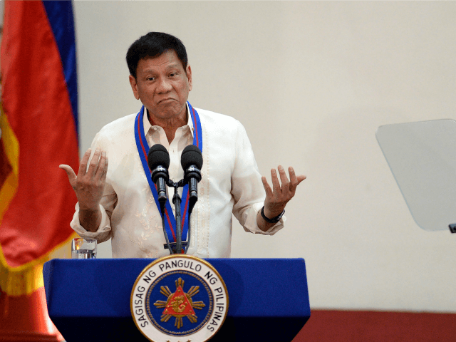 Philippine President Rodrigo Duterte gestures as he talks during the Assumption of Command Ceremony of Philippine National Police (PNP) chief Ronald Bato Dela Rosa at the Camp Crame in Manila on July 1, 2016. Authoritarian firebrand Rodrigo Duterte was sworn in as the Philippines' president on June 30, after promising …