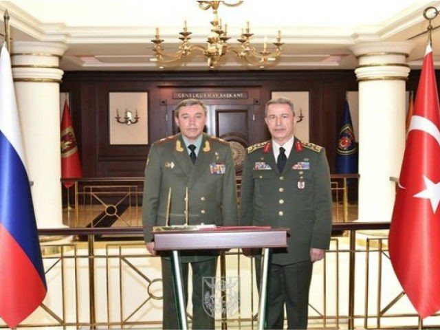 Turkey's Chief of Staff Gen. Hulusi Akar, right, and his Russian counterpart Gen. Valery Gerasimov pose for a photograph before their talks in Ankara, Turkey, Thursday, Sept. 15, 2016. Turkey's state-run news agency says the Russian and Turkish chiefs of general staff met Thursday afternoon at the Turkish military headquarters following a greeting ceremony. Turkish media said the two are expected to discuss the latest developments in Syria and bilateral cooperation.(Turkish Military, Pool photo via AP )