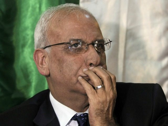 Saeb Erekat, Chief Palestinian negotiator, gestures during a press conference in Jerusalem on March 19, 2015. The Palestine Liberation Organisation (PLO) executive committe was given two weeks to work out the modalities to end the security cooperation with Israel, Erekat said. AFP PHOTO / AHMAD GHARABLI (Photo credit should read …