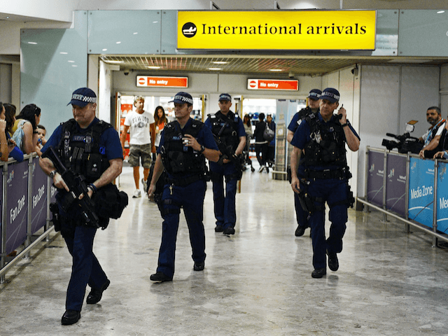Armed UK police Heathrow Airport