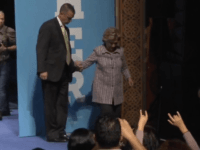 Watch: Hillary Clinton Steadies Herself Before Going Down Stairs
