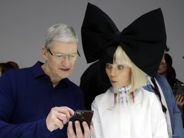 Tim Cook iPhone 7 (Marcio Jose Sanchez / Associated Press)