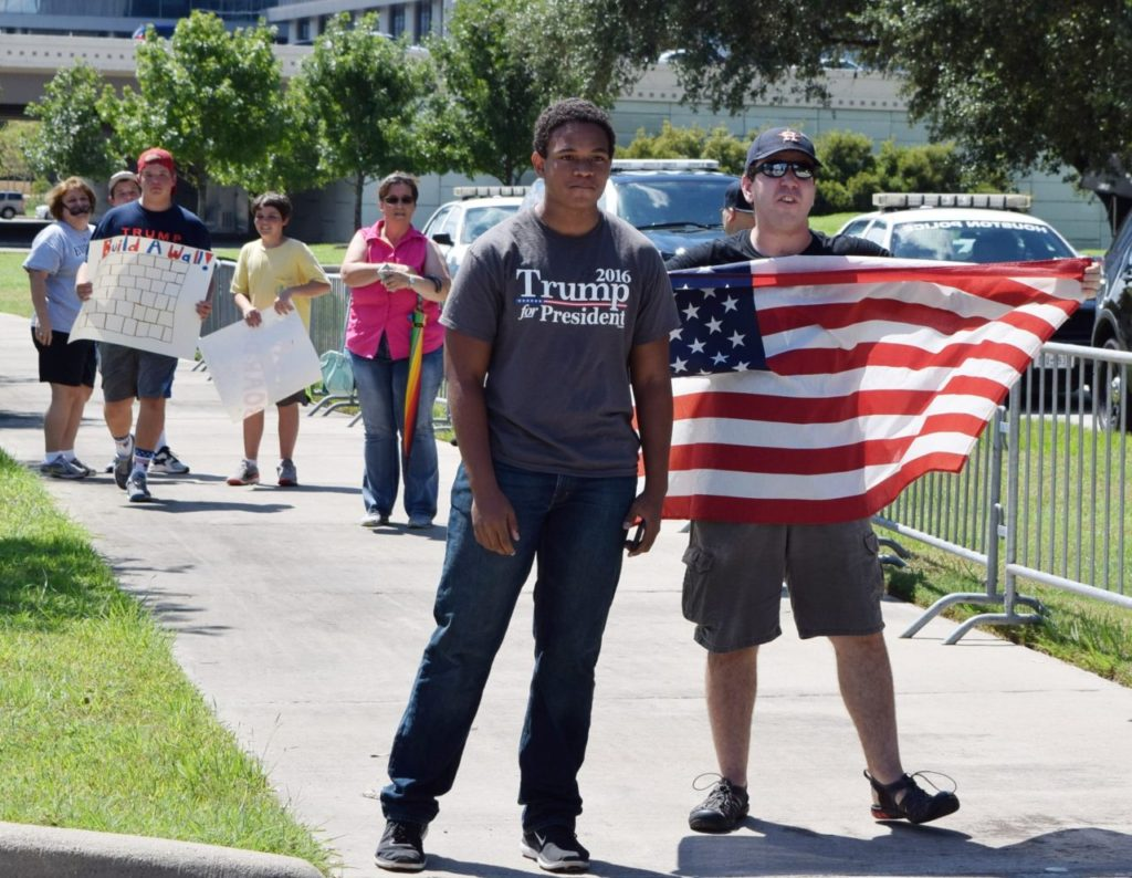 Marcel McClinton, left, with pro-Trump supporters. (Photo: Bob Price/Breitbart Texas)