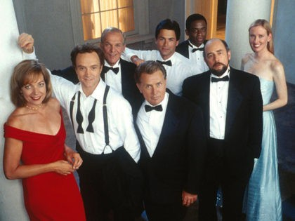 The cast of the Emmy award-winning drama series 'The West Wing' poses for a publicity photo. In the front row, from left to right, are Allison Janney, Bradley Whitford, Martin Sheen, Richard Schiff, and Janel Moloney. In the back row, from left to right, are John Spencer, Rob Lowe, and …