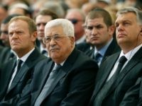 Palestinian president Mahmud Abbas (C) sits alongside European Council President Donald Tusk (L) and Romanian President Klaus Iohannis at Jerusalem's Mount Herzl national cemetery during the funeral of former Israeli president Shimon Peres on September 30, 2016. / AFP / POOL / ABIR SULTAN (Photo credit should read ABIR SULTAN/AFP/Getty Images)
