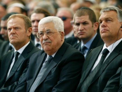 Palestinian president Mahmud Abbas (C) sits alongside European Council President Donald Tusk (L) and Romanian President Klaus Iohannis at Jerusalem's Mount Herzl national cemetery during the funeral of former Israeli president Shimon Peres on September 30, 2016. / AFP / POOL / ABIR SULTAN (Photo credit should read ABIR SULTAN/AFP/Getty …