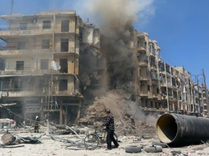A man walks past the rubble of a building following reported shelling by Syrian government forces in the Bab al-Hadid neighbourhood of the northern city of Aleppo on April 18, 2015. Aleppo has been devastated by fighting since rebel fighters seized its eastern half in 2012, setting up a front …