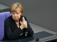 BERLIN, GERMANY - JULY 03: German Chancellor Angela Merkel attends a meeting of the Bundestag, Germany's federal parliament, about a vote on exceptions to the minimum wage law to take effect from next year on July 3, 2014 in Berlin, Germany. The country voted for a minimum wage of 8.50 …