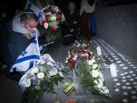People light candles and place Israeli flags on February 16, 2015 in front the Danish Embassy in Brussels for the the victims of weekend attacks on a cultural center and a synagogue in Copenhagen that left two people dead including a 37-year-old Jewish man as well as a 55-year-old film-maker …
