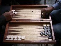 Egyptians play backgammon at a cafe in Cairo on November 24, 2014. Six months after Abdel Fattah al-Sisi became Egypt's president a deadly crackdown on Islamist supporters of Sisi's predecessor Mohamed Morsi, whom he ousted last year has generated a climate of fear at train and bus stations, public squares …