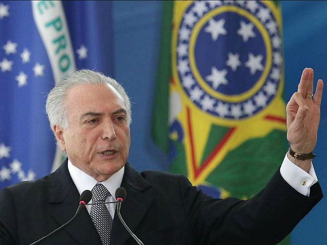 Brazil's President Michel Temer speaks during a ceremony, at the Planalto Presidential Palace, in Brasilia, Brazil, Wednesday, Sept. 14, 2016. Temer has rubbed elbows with world leaders in China, been vociferously booed at important national events and signaled he will move forward with unpopular reforms, such as trimming pension benefits. …