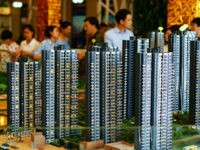 --FILE--Chinese homebuyers look at housing models at the sales center of a residential property project in Yichang city, central China's Hubei province, 4 June 2016. China's new home sales rose at the slowest pace so far this year amid policymakers' moves to cool the property market. New home sales climbed 32.9 percent to 773 billion yuan ($117 billion) in May from a year earlier, according to data the National Bureau of Statistics released Monday (13 June 2016). The increase compares with a 63.5 percent surge in April. Home sales fell 2.6 percent in May from April.(Imaginechina via AP Images)