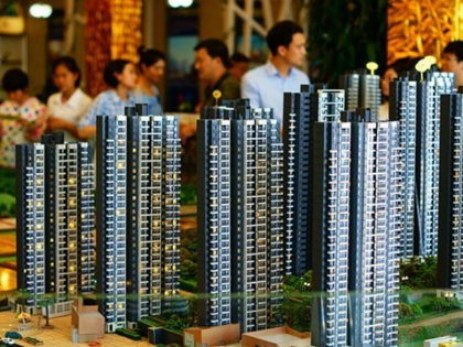 --FILE--Chinese homebuyers look at housing models at the sales center of a residential property project in Yichang city, central China's Hubei province, 4 June 2016. China's new home sales rose at the slowest pace so far this year amid policymakers' moves to cool the property market. New home sales climbed …