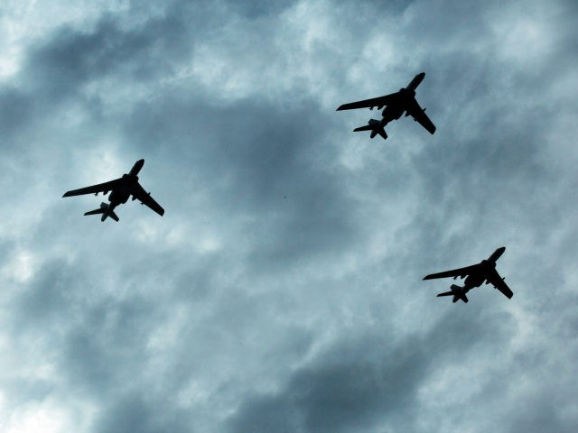 Chinese military planes take part in rehearsals ahead of the Sept. 3 military parade to commemorate the end of World War II in Beijing, Sunday, Aug. 23, 2015. China is ramping up publicity for its upcoming massive military parade but officials still aren't saying what other countries are taking part. (AP Photo/Ng Han Guan)