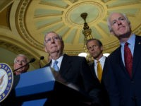 FILE - In this Sept. 13, 2016 file photo, Senate Majority Leader Mitch McConnell of Ky., second from left, standing with, from left, Sen. Roger Wicker, R-Miss., Sen. John Thune, R-S.D., and Senate Majority Whip John Cornyn, of Texas, listens to a question during a news conference on Capitol Hill …