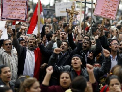 Egyptian Coptic Christians chant slogans during a demonstration outside the state television building in central Cairo on March 9, 2011 a day after ten people have been killed in religious clashes between Muslims and Copts in the city when Christians gathered to protest the burning of a church last week. …