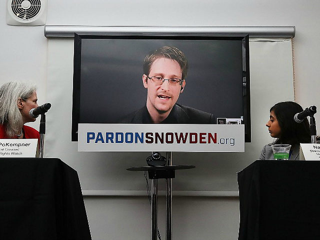 NEW YORK, NY - SEPTEMBER 14: Edward Snowden speaks via video link at a news conference for the launch of a campaign calling for President Obama to pardon him on September 14, 2016 in New York City. The campaign, which includes representatives from the American Civil Liberties Union, Human Rights Watch, Amnesty International and ACLU attorney Ben Wizner, looks to have the whistle blower pardoned from under the Espionage Act. (Photo by Spencer Platt/Getty Images)