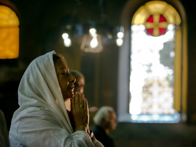 An Egyptian Coptic Christian prays during a service for the departed remembering the victims of EgyptAir flight 804, at Al-Boutrossiya Church, the main Coptic Cathedral complex in Cairo, Egypt, Sunday, May 22, 2016. The Airbus A320 plane was flying from Paris to Cairo with 66 passengers and crew when it disappeared early last Thursday over the Mediterranean Sea. (AP Photo/Amr Nabil)