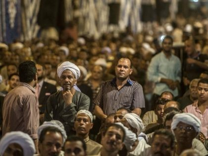 Egyptian men attend a campaign meeting of the main 'For The Love of Egypt' coalition ahead of the parliamentary elections on September 29, 2015 in the city of Qena, some 650 km (400 miles) south of Cairo. The current mood in the Arab world's most populous nation was evident at …