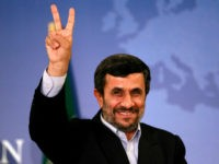 Mahmoud Ahmadinejad gestures as he leaves a news conference in Istanbul, Turkey May 9, 2011. REUTERS/Murad Sezer/File Photo